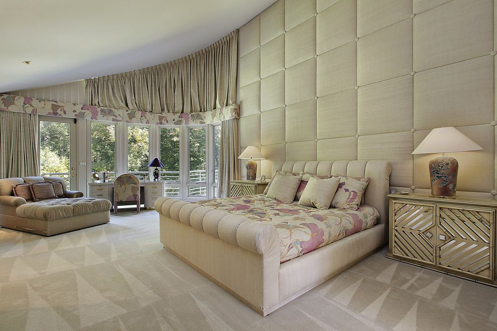 Giant Bedroom Featuring Rounded Window Corner, Cushioned Wall Covering With  Matching Bed Frame, Patterned