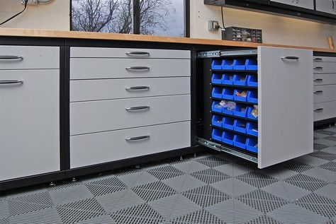 Why not each cabinet be rolling and mobile then easily stored under the workbench when not in use??? And they could be labeled. And the floor could be a color different from most nails and screws.