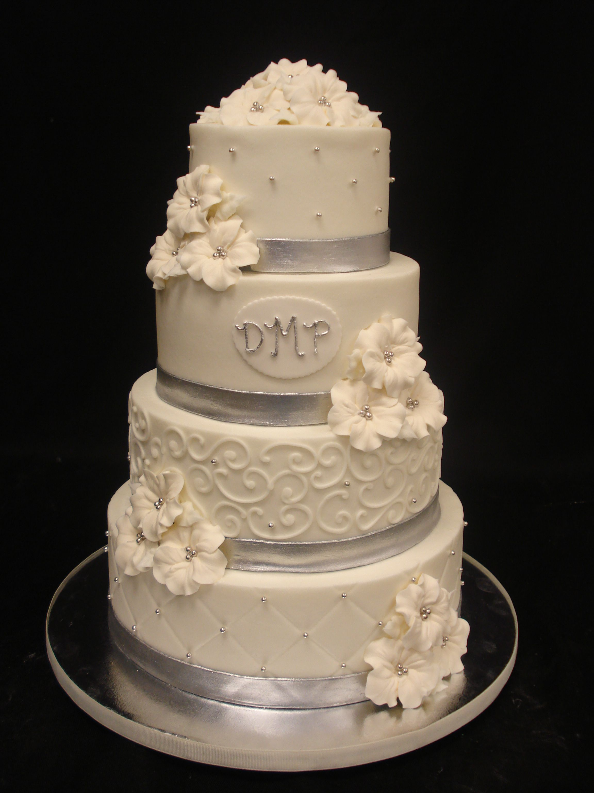 White And Silver Wedding Cake With Monogram Party Flavors Custom Cakes Orlando FL