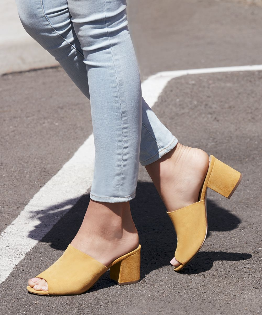 7818147785b945 Suede mules in mustard yellow