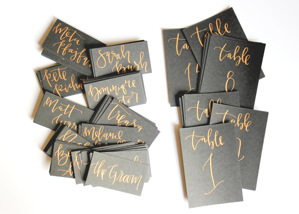 gold modern calligraphy place cards and table numbers