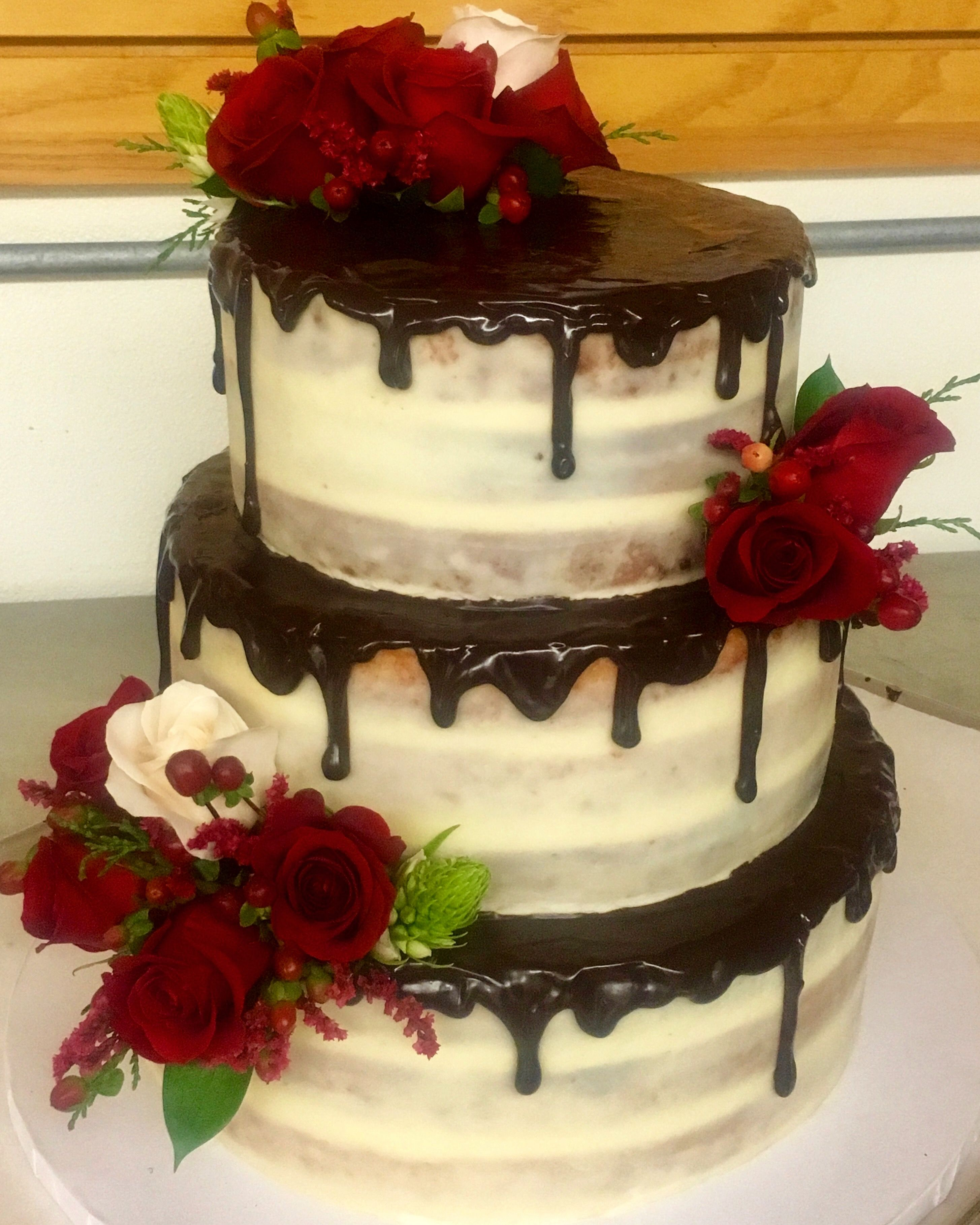Gluten-free marble cake with buttercream and ganache filling, topped ...