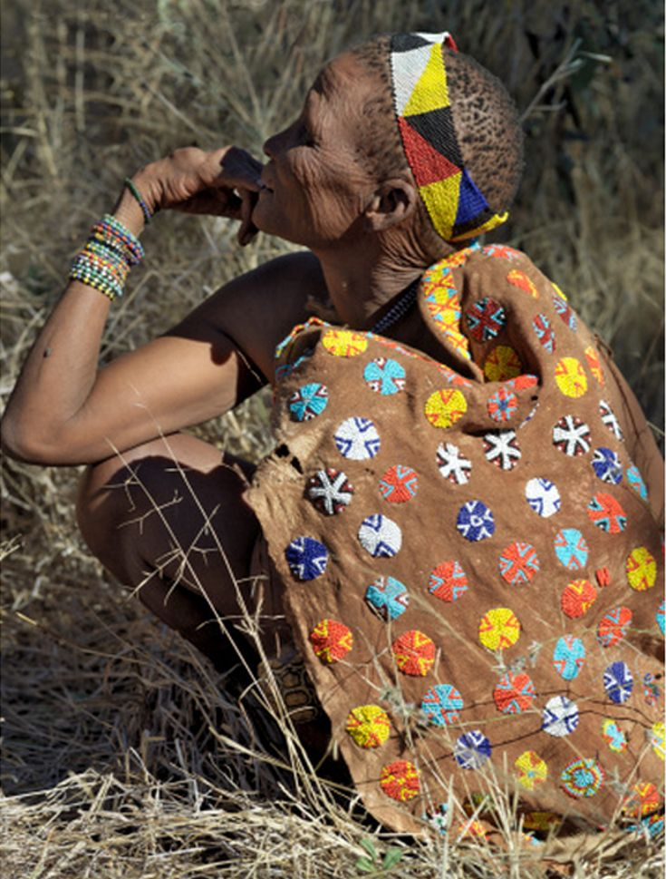 Africa | A San woman wears a beautifully decorated leather cape. Botswana, near the Botswana-Namibia border | ©Nigel Pavitt