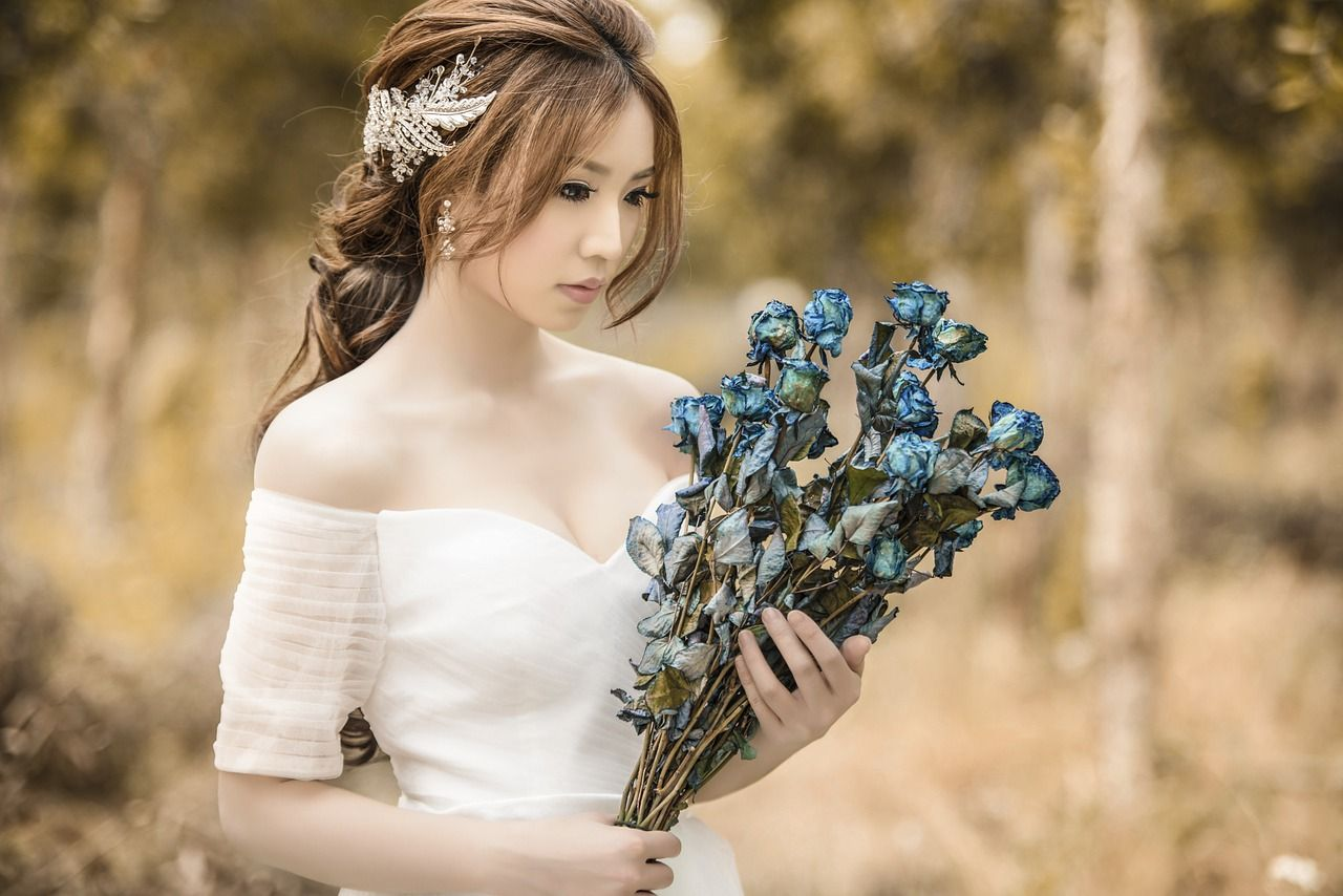 Bride holding bouquet in forest