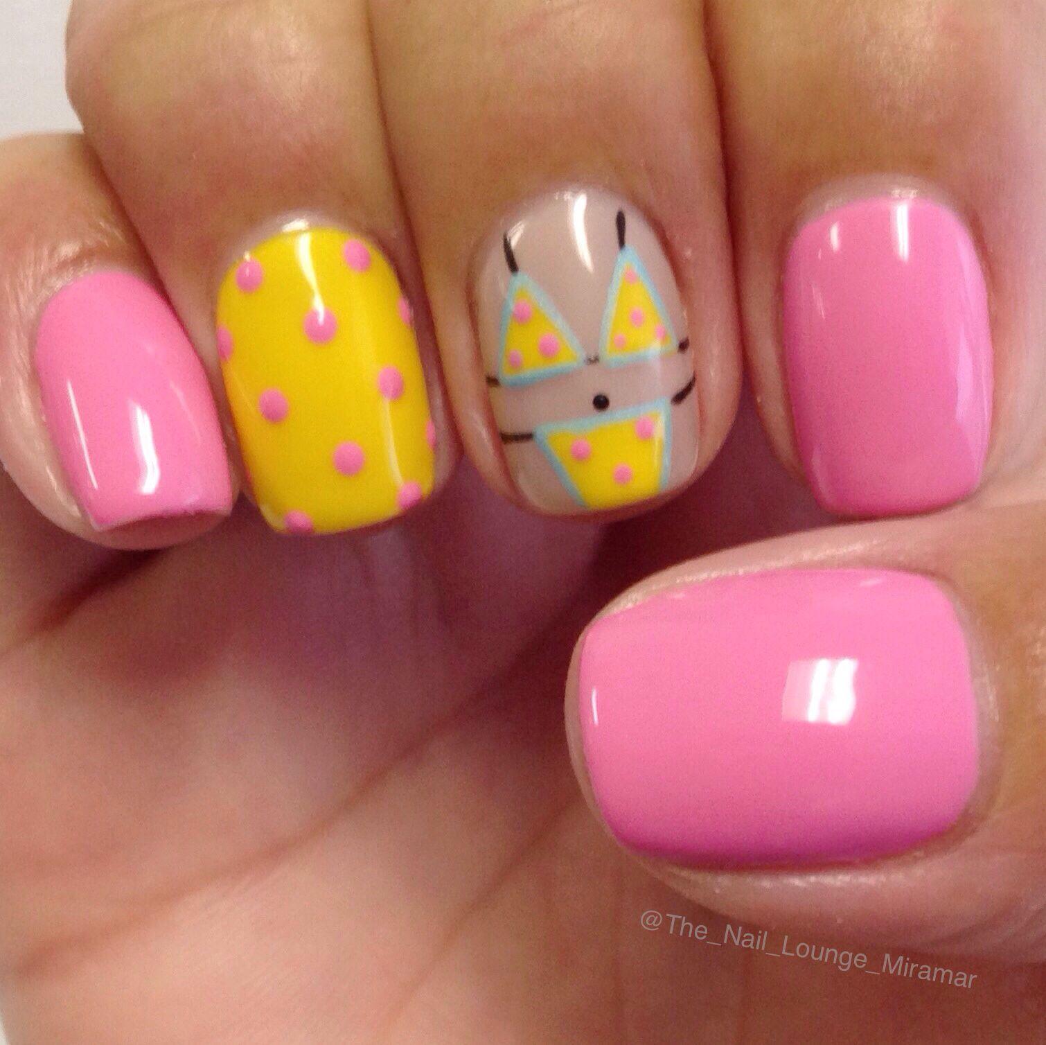 Yellow polka dot bikini nail art design