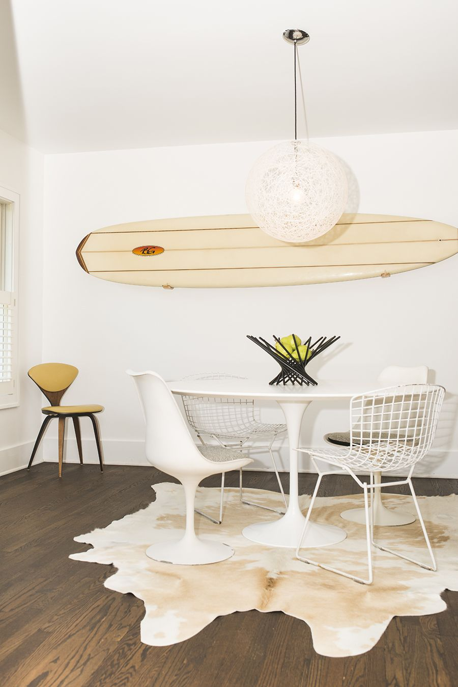 Cowhide Rug, Designer Eero Saarinen For Knoll Saarinen Round Dining Table,  Designer Eero Saarinen For Knoll Saarinen Armless Tulip Chairs, Designer  Harry ...