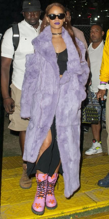 Rihanna in a fluffy purple coat