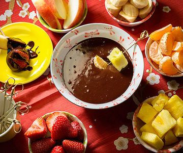 Chocolate Fondue - Kids love to dip, especially when they're dunking fruit into melted chocolate. This rich dessert comes together in minutes and is perfect party fare. #healthy #snacks