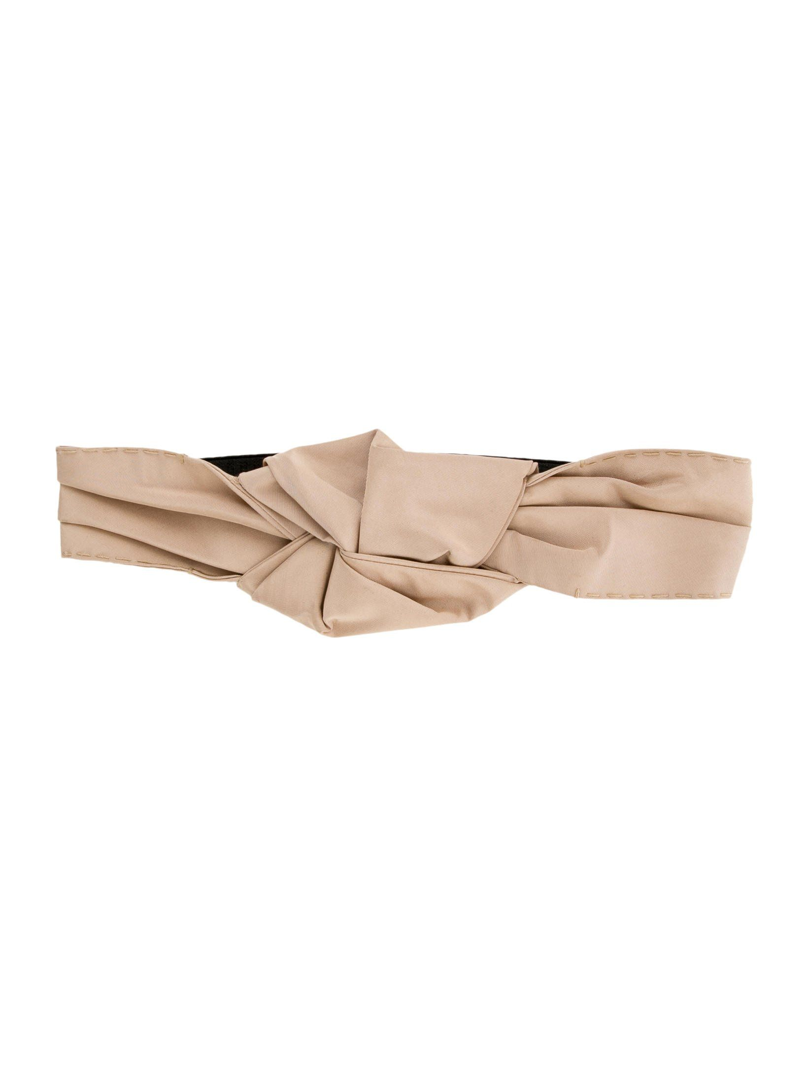 Beige Tessuto Prada headband with knot accent at top and elasticized trim at back.