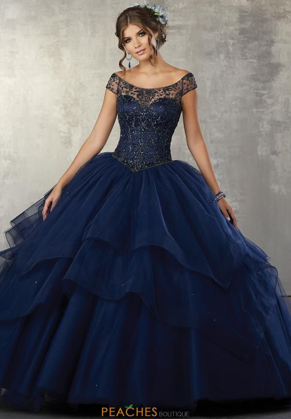 Vizcaya Quinceanera Cap Sleeved Beaded Gown 89172 - Quinceanera dresses blue, Quincenera dresses, Sweet 15 dresses, Quinceanera dresses, Turquoise quinceanera dresses, 15 dresses quinceanera - Look marvelous in this one in million ball gown by Vizcaya style 89172 that showcases a fashion forward illusion straight across neckline and cap sleeves with a sweetheart underlay  The form fitting bodice is adorned with an array of beads and tones and has a corset lace up closure  The long full tulle skirt has unique tiered pointed layers, find this dress at Peaches Boutique