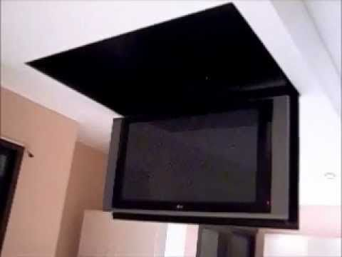 Motorized flip down tv lift from the ceiling youtube for Motorized tv mount cabinet