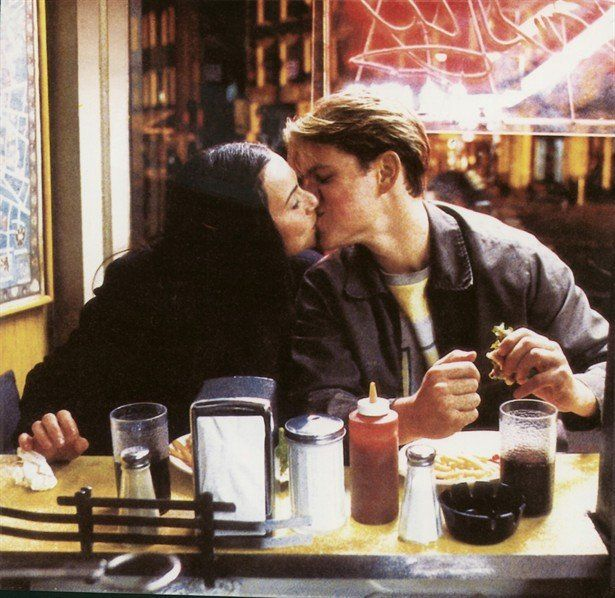 Good Will Hunting. Skylar (Minnie Driver) and Will (Matt Damon) kiss while they eat to get the first kiss out of the way. Source: Miramax
