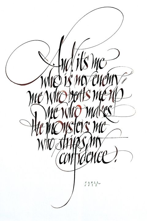 Calligraphy quote written out on paper with sepia and