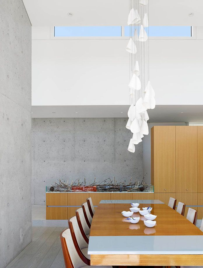 Dining area with extraordinary pendant.