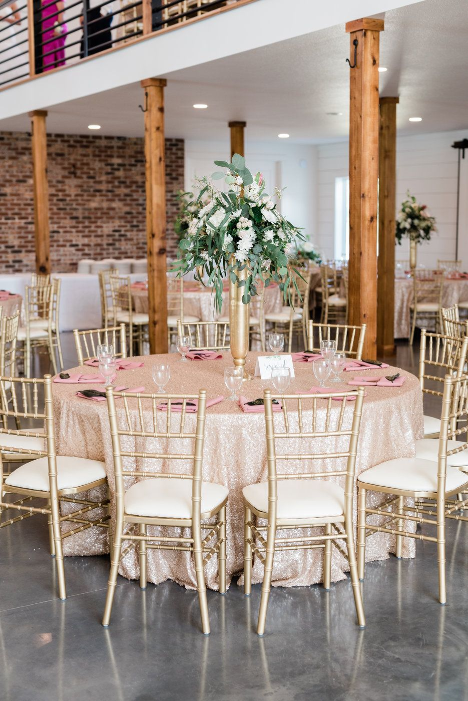 A main floor that seats up to 180 guests with a brick ...