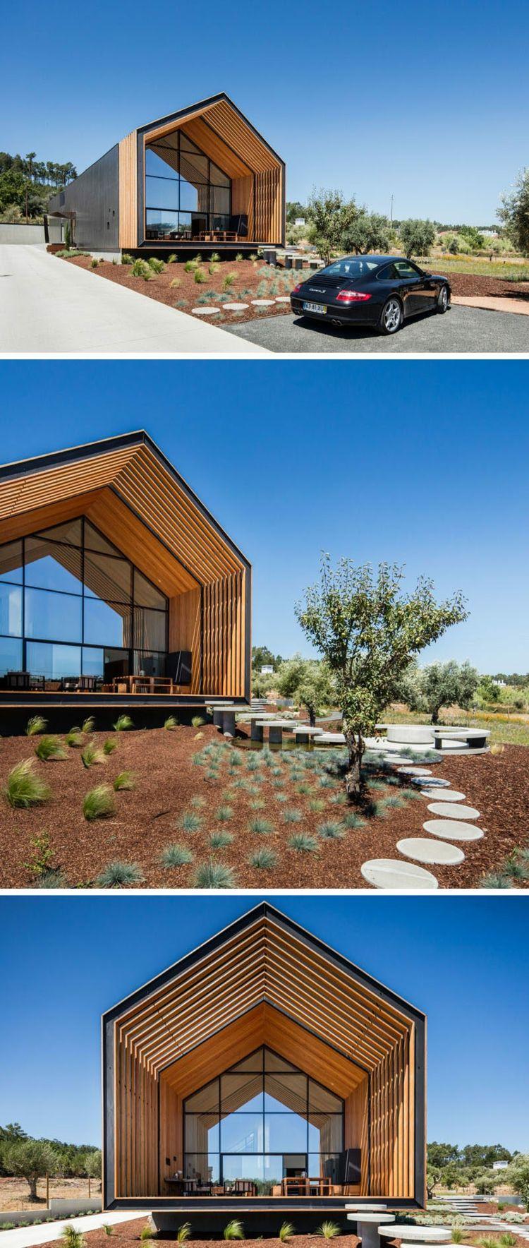 Form haus schwarzer beton holz veranda aus holz garten traumhäuser modern family house