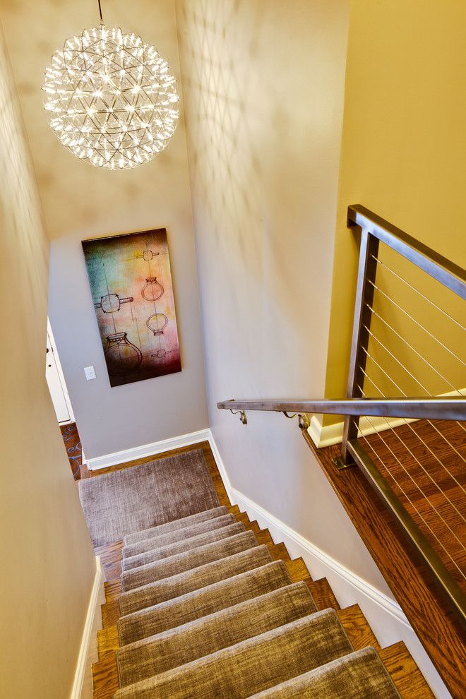 Artwork and unique lighting enhance this stairwell Seven