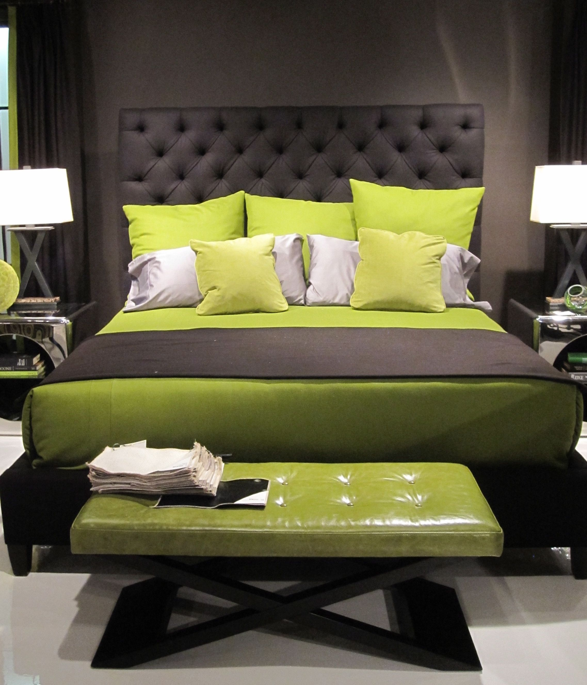 upholstered gray bed styled with greens and stainless accent