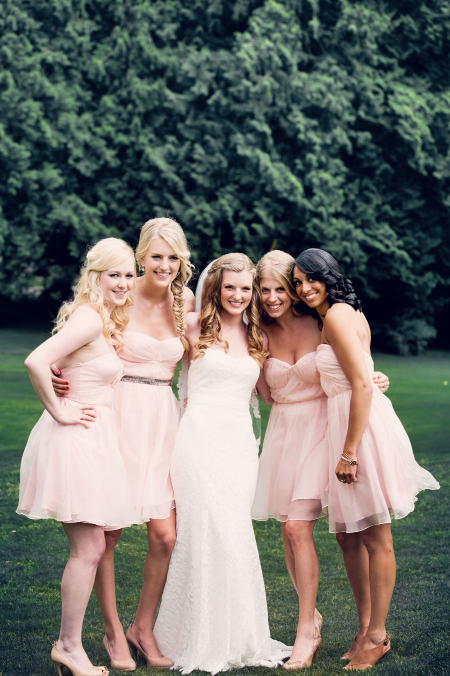 Short Pink Flirty Bridesmaids || On Style Me Pretty Weddings: http://www.StyleMePretty.com/canada-weddings/2014/02/13/romantic-west-vancouver-wedding/  Jamie Lauren Photography
