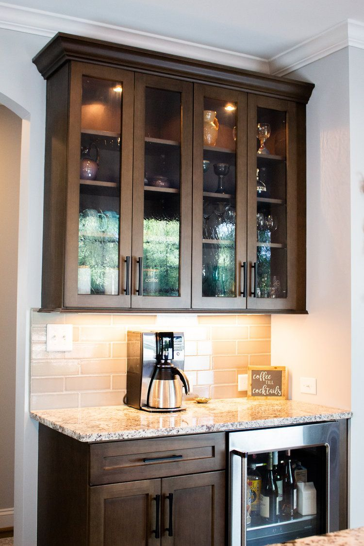 Beautiful cabinetry, ceramic backsplash, and granite ...