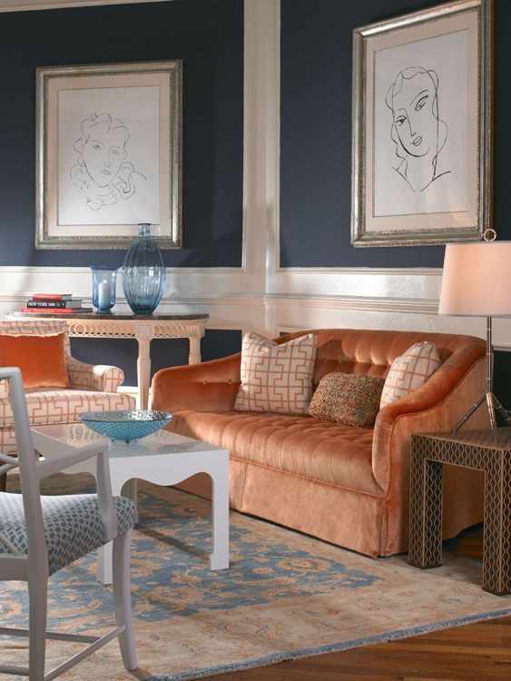 Love the navy walls with Oscar de la Renta's coral sofa. Bold!