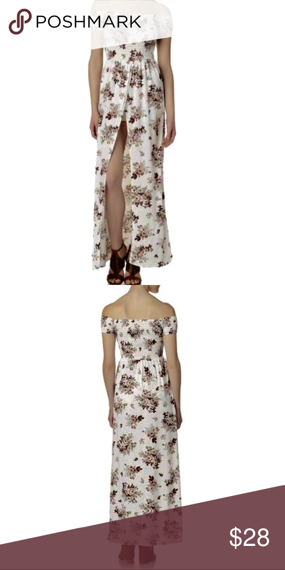 4076f730f52a White Flower 🌺 Smocked Maxi Dress Romper A charming floral print fronts  this maxi romper from