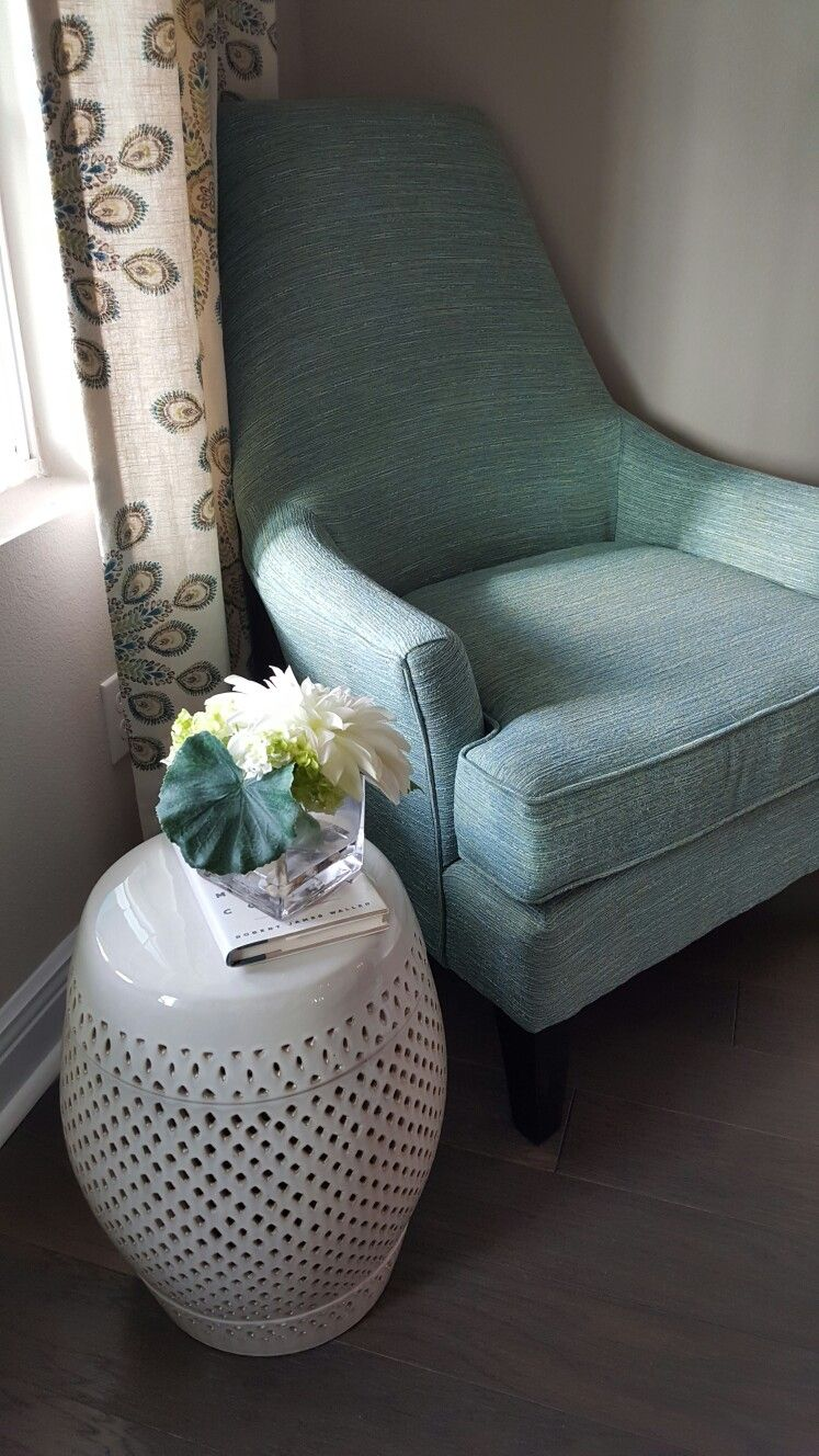 accent chair with a table in teal color new construction in