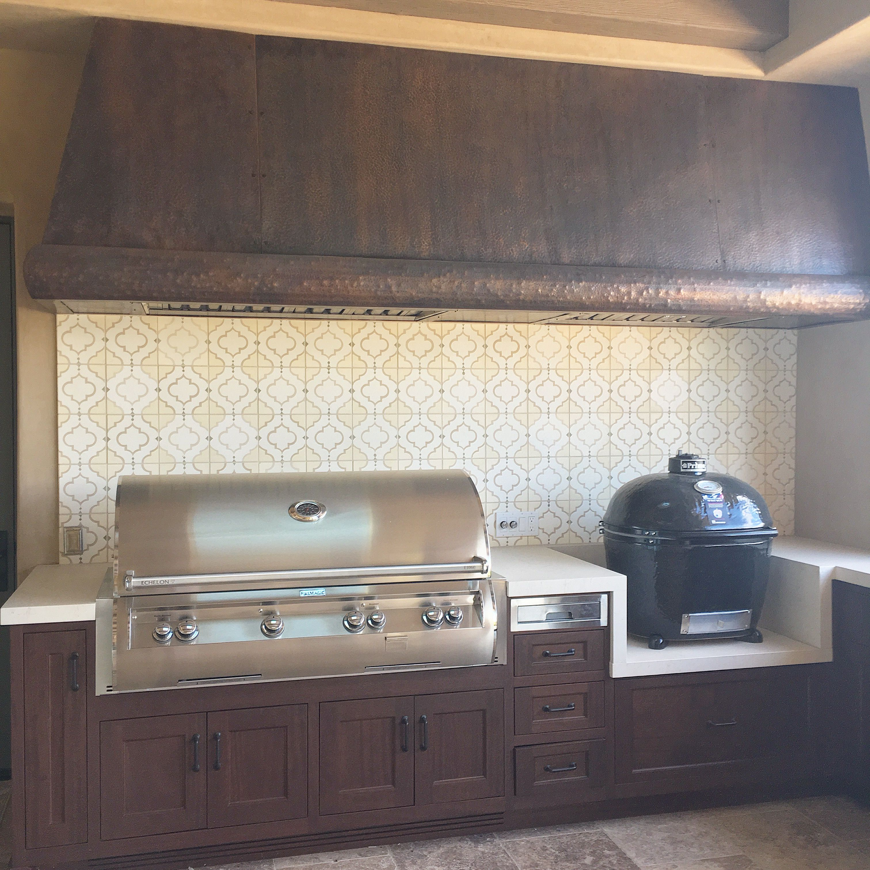 Outdoor Kitchen With Cement Tile Backsplash And Custom Hammered