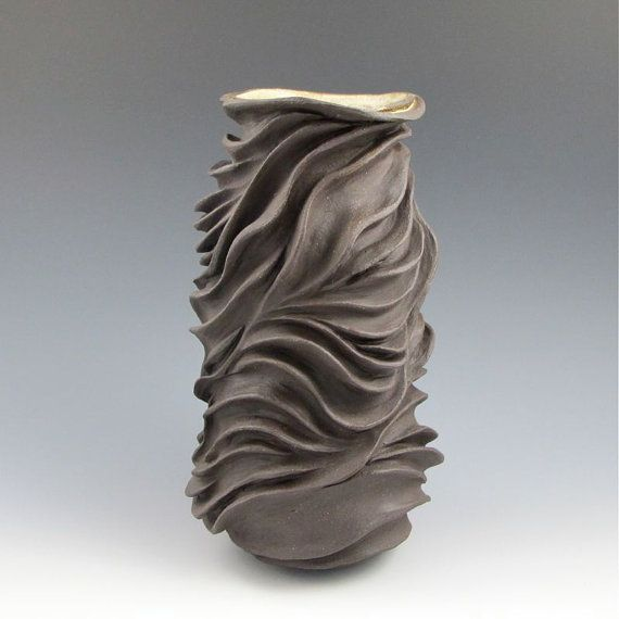Beautiful deep carving on wheel thrown pots pottery