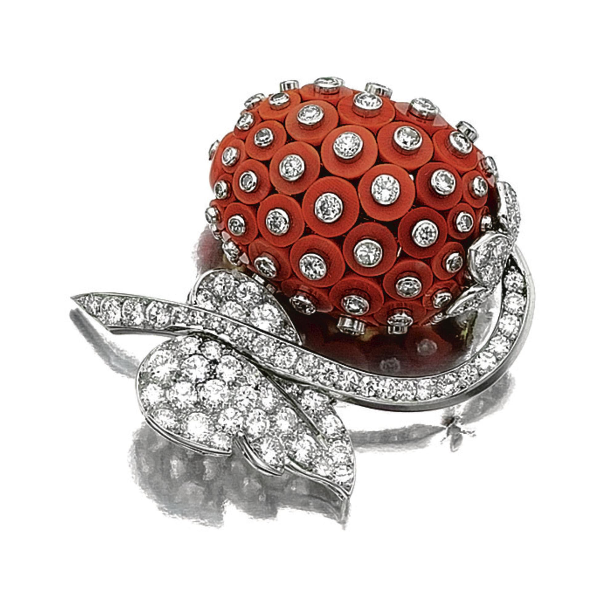 CORAL AND DIAMOND BROOCH, CARTIER, 1950S. Of stylised floral design, set with coral discs studded with circular-, single- and brilliant-cut diamonds, the stem and leaf set with similar stones, mounted in platinum, signed Cartier Paris, French assay and maker's marks.