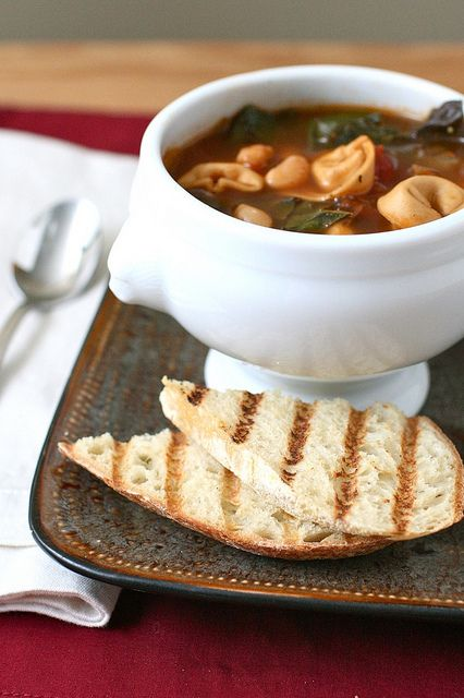 Tortellini Soup with Beans and Chard (I'd swap kale for the Chard) -- it even uses whole wheat tortellini