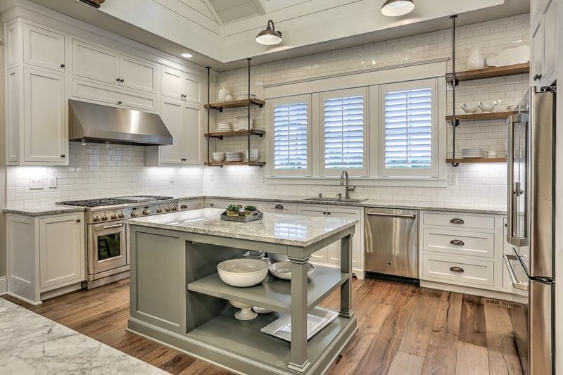 We came across this stunning kitchen designed by ...