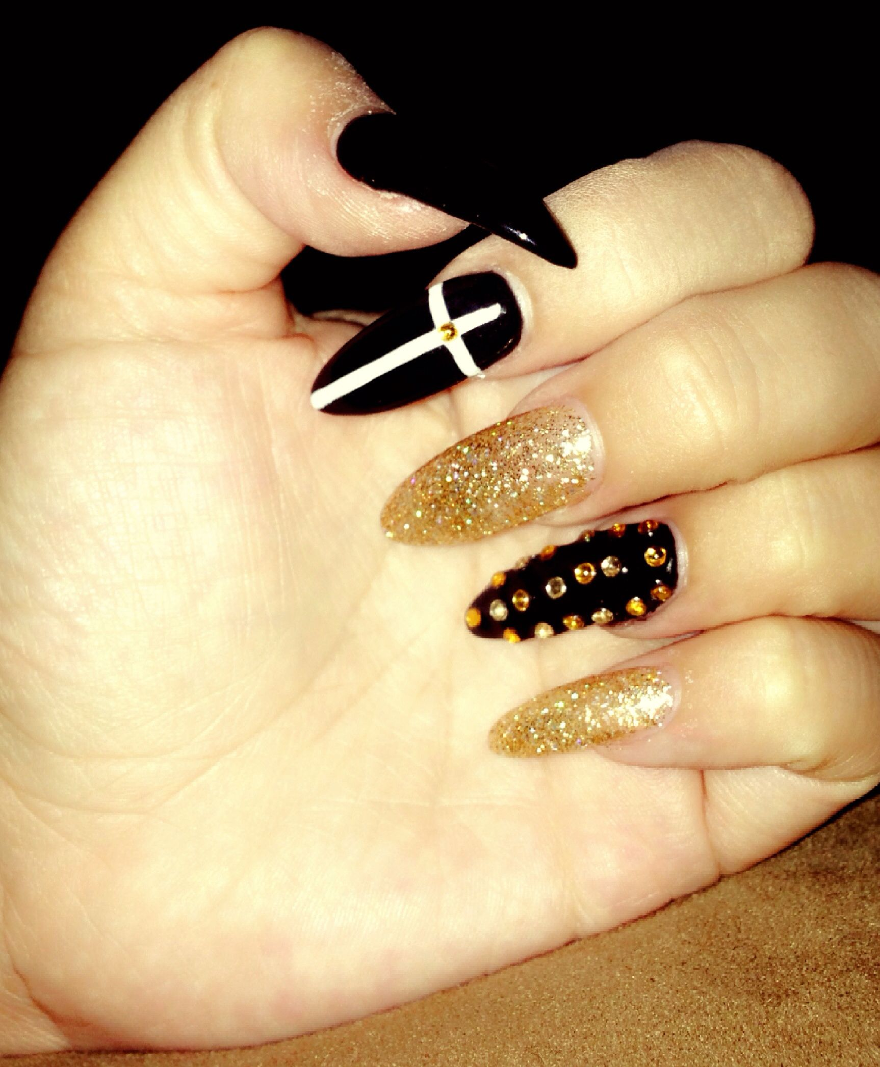 Acrylic Nails With Blackglitter Gold Gel Polish Pointed Tip Rhinestone White Cross Design You Like Done At Cool In Cerritos