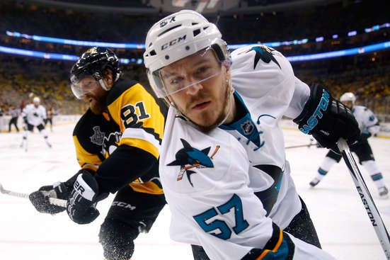 Tommy Wingels of Sharks battles for puck with Penguins Phil Kessel ...