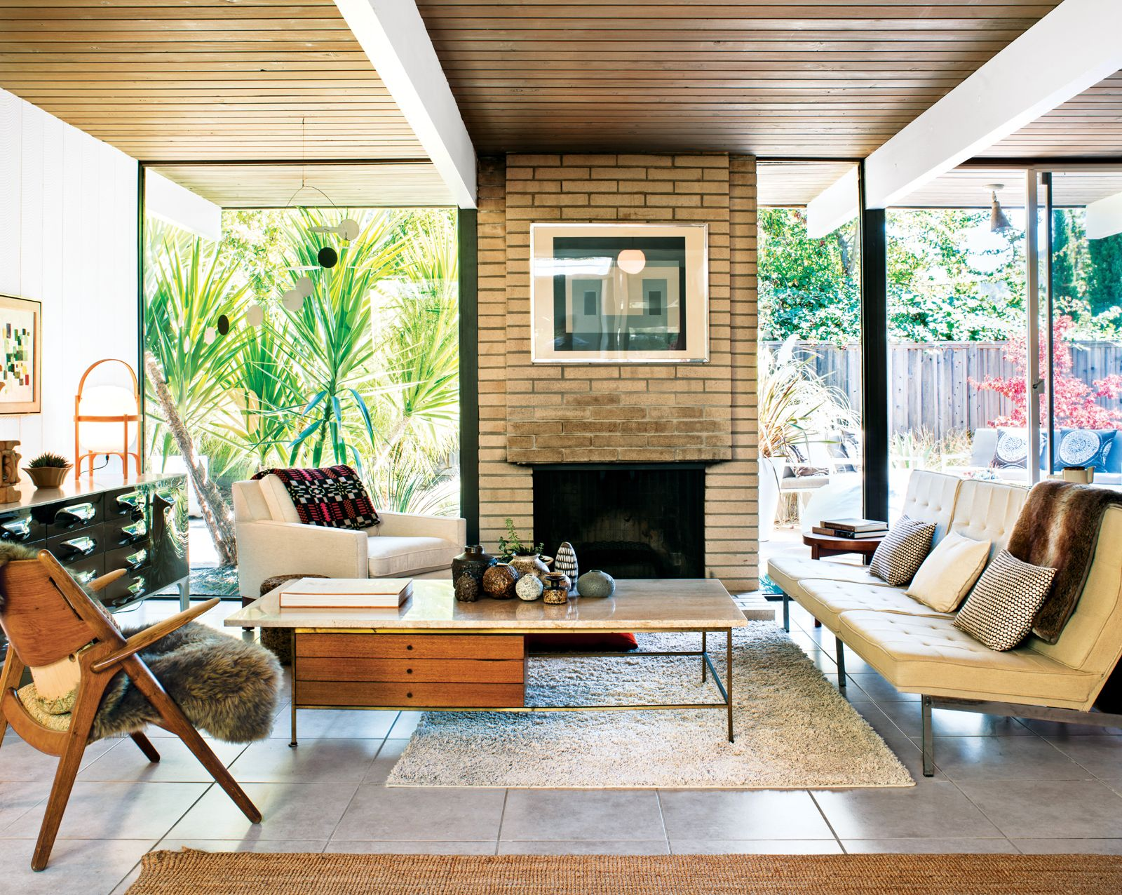 In the living room of a classic eichler a travertine topped coffee table by