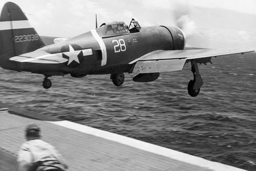 A P-47 Thunderbolt takes off from an aircraft carrier in the Pacific Ocean.