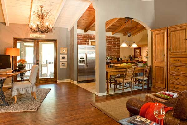 cottage-style comeback for a 1950s stucco ranch | exposed brick