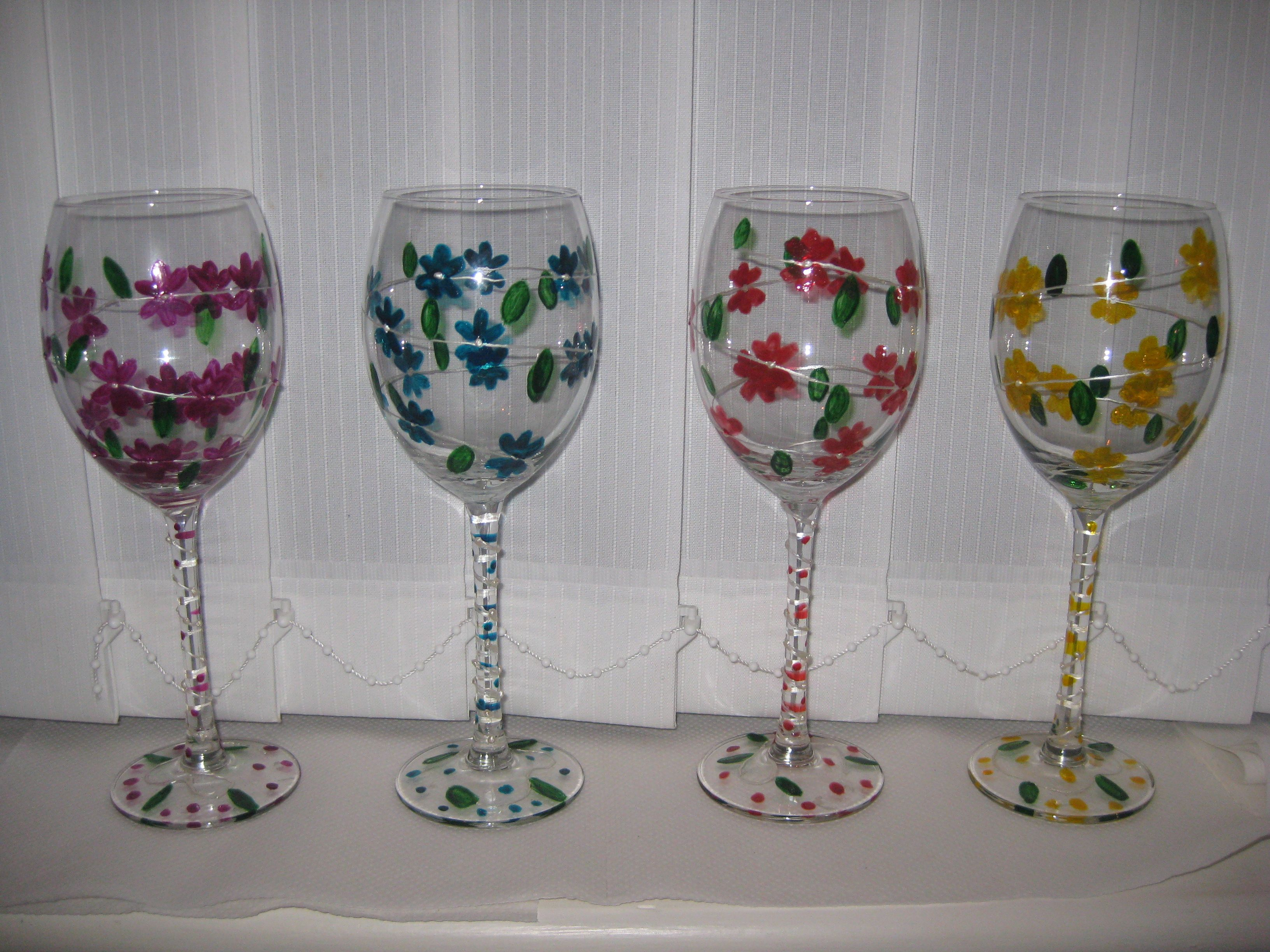 Free images to paint on glass flowers set of 4 painted for Type of paint to use on wine glasses