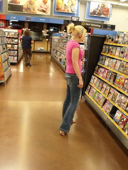 Sexy girl standing barefoot
