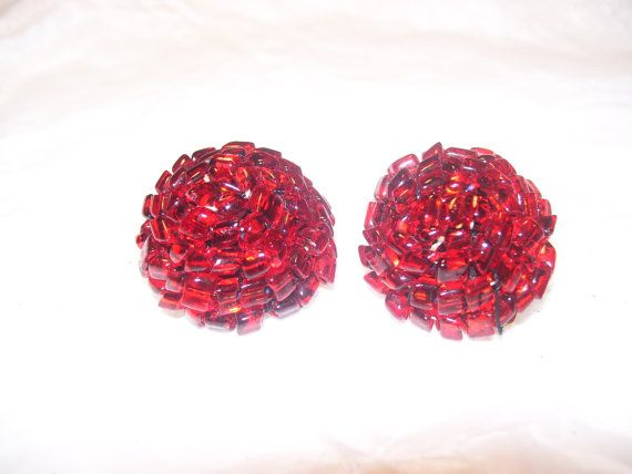 These are beautiful vintage earrings. Made from small ruby red transparent beads set in a rose pattern. They are clip on earrings from the
