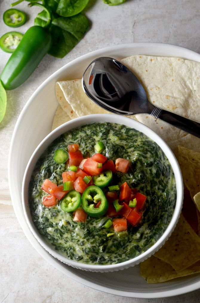 Jalapeño Queso Blanco Creamed Spinach. Whether you serve it as a dip or a side dish you're going to fall in love with this Mexican-inspired recipe. | hostthetoast.com