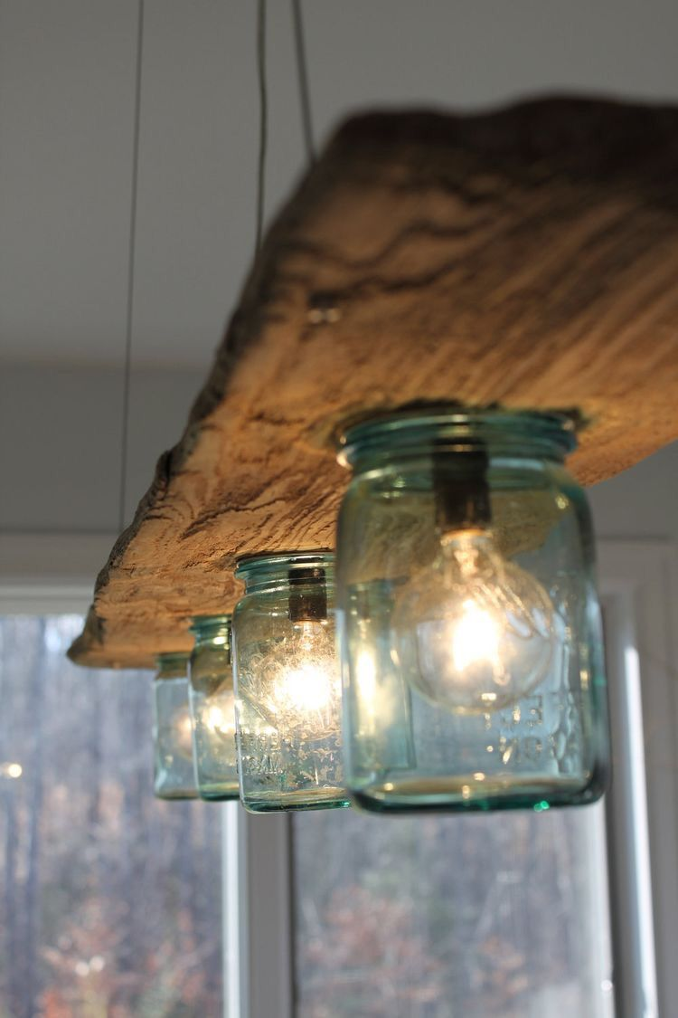 Driftwood and Antique Jar Hanging Light. Seriously in love with this beachy light  fixture idea! Perfect for a kitchen!