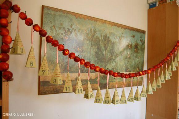 Advent calendar paper pyramids on a mini apple garland