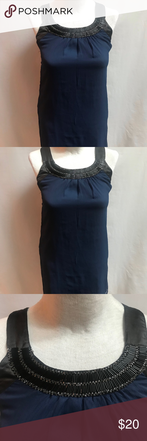Sally Miller Couture Beaded Chiffon Navy Tank M Lovely Sally Miller Couture tank top.  Navy chiffon; fully lined; Black satin straps and armbands with beaded trim along top of front bodice.    Size Medium; very good used condition 100% polyester  Measurements taken with item laying flat: chest (armpit to armpit) 15 1/2 waist 17 bottom of back to hemline 22  Machine wash cold, line dry  Thank you for visiting my closet! Sally Miller Tops Tank Tops #sallymiller