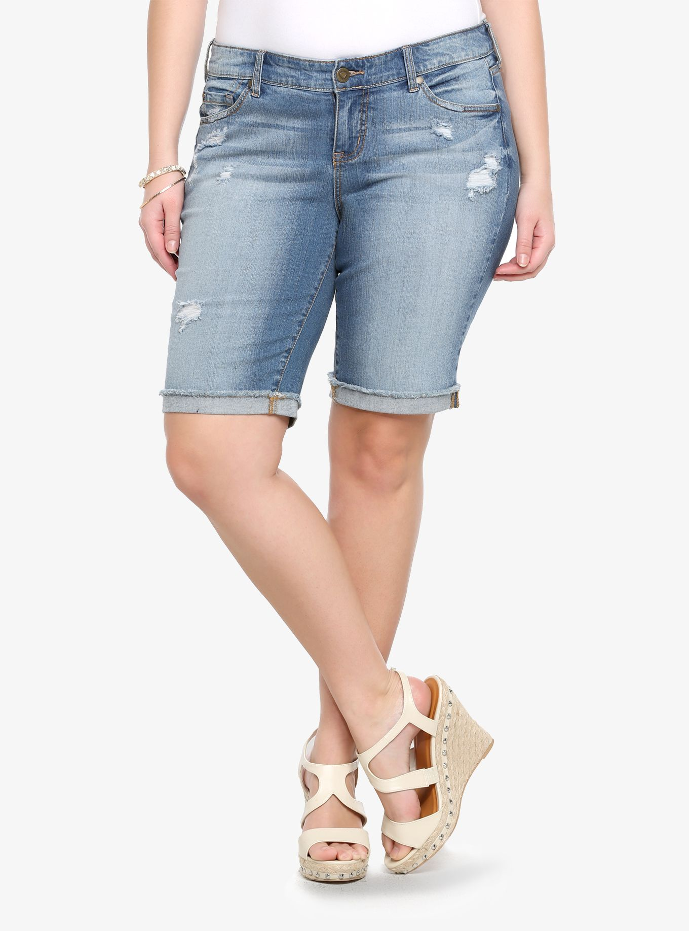 Our new White Label denim is casual American style - designed and fit just for you. It's authentic, lived-in fashion that's fun and sexy. Wear what you love.Our destructed boyfriend Bermuda shorts are eased through the hip and thigh with a frayed cuffed hem. The light washed denim has an authentic, classic feel.