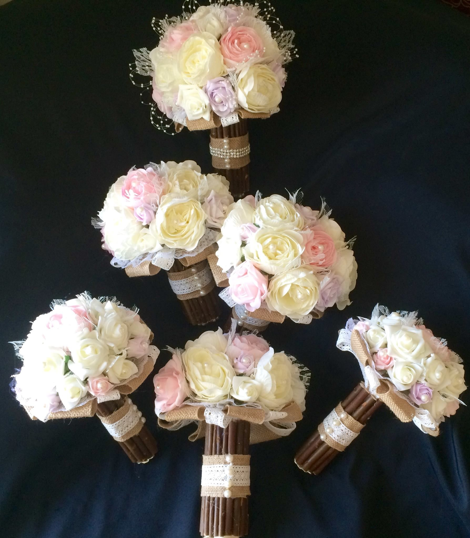 Pale pink/ivory roses with wooden splints for the handles. Then a little burlap with lace for that vintage wedding!!! by Karen @ www.bouquetswithlove.co.uk https://www.facebook.com/Bouquetswithlove/