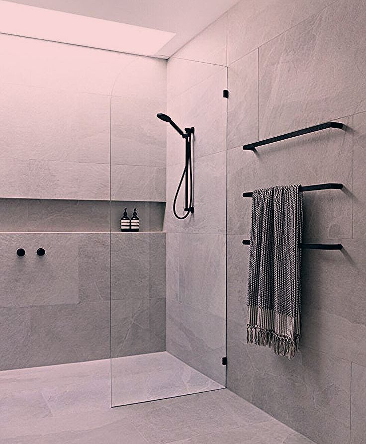 Bathroom Grey Ensuite bathroom with skylight grey tiles black taps and frameless glass