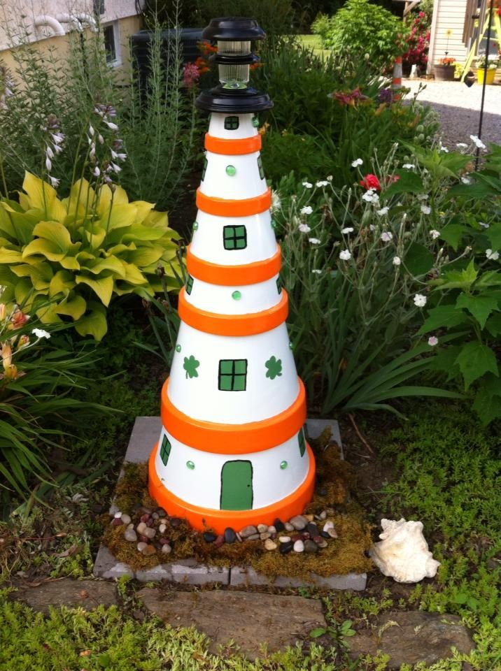 Irish themed lighthouse made from terra cotta pots Terra