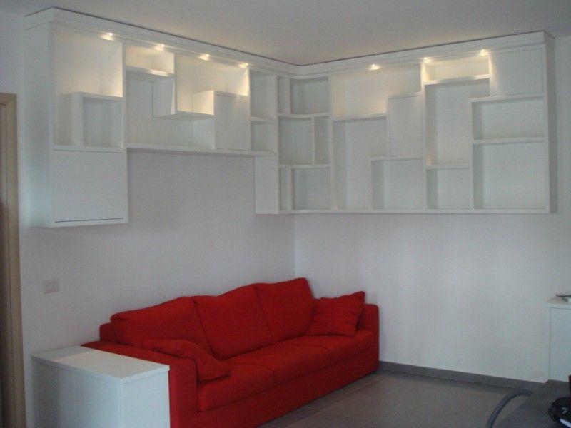 Faretti Soggiorno ~ Libreria in stile moderno ad angolo e sospesa per soggiorno