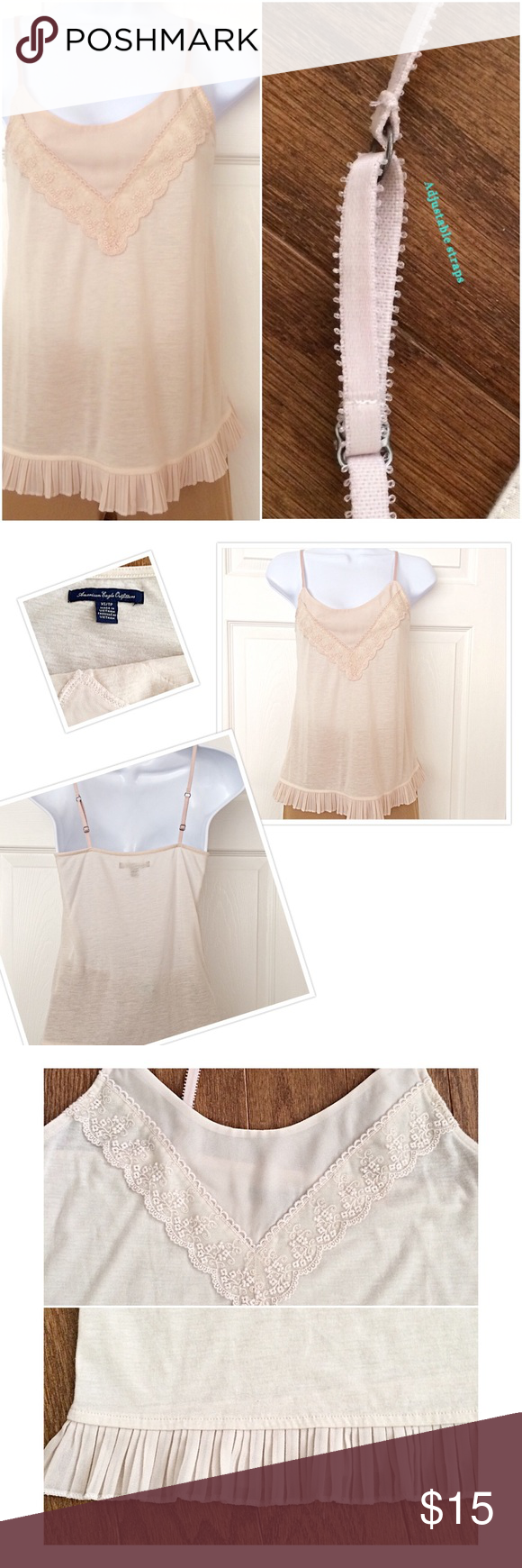 """AMERICAN EAGLE OUTFITTERS Beautiful Strap Top A really nice top. Soft, smooth,  lightweight Cotton blend & sheer   fabric tank top with adjustable bra strap. Adjusts from length 22""""-24"""". Width underarm to underarm 14"""". Lace & sheer ivory beige add detail on a curved neckline. To finish a sheer ruffle to waist. Looks great with jeans, trousers or a skirt American Eagle Outfitters Tops Tank Tops"""